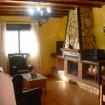 Casa rural Villa Rocio Salón y chimenea